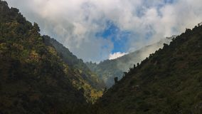 Himalayan Valley near Dharamshala, India. Clouds gathers above a V-shaped valley near the Himalayan hill-station of Dharamshala Royalty Free Stock Photos
