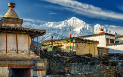 Himalayan village of Kagbeni. Old Buddhist stupa in the village of Kagbeni with Nilgiri North in the background, Annapurna Circuit Trek, Nepal Royalty Free Stock Photos