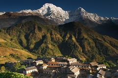 Himalayan village in Nepal. Himalayan village and Annapurna massif, Nepal Stock Photo