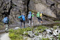 Hikers with backpack on trekking trail in Himalayas mountains. Nepal stock photography