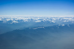 Himalayas bird's eye view. From window of plane stock photos