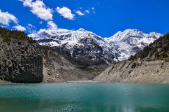 Himalayas mountain peaks and lake - Gangapurna lake Royalty Free Stock Photography