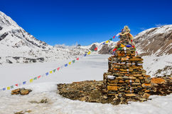 Himalayas mountains frozen lake and stone stop Stock Images
