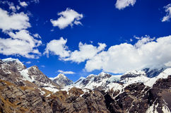 Himalayas mountains range snow peaks and clouds Royalty Free Stock Photos