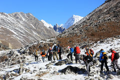HIMALAYAS, NEPAL - MARCH, 2014: Group of tourists coming down fr Royalty Free Stock Photos