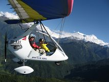 HIMALAYAS, POKHARA, NEPAL. 28 September 2008: Foreign tourist flying on a hang glider deltaplan. royalty free stock photos