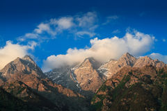 Himalayas summits in clouds on sunset Royalty Free Stock Images