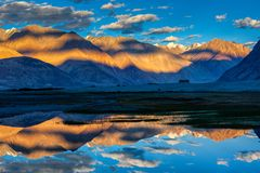 Himalayas on sunset, Nubra valley, Ladakh, India. Himalayas on sunset with camel caravan. Hunber, Nubra valley, Ladakh, India Stock Images