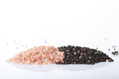 Himalayn rock salt and peppercorns Royalty Free Stock Photography