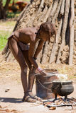Himba Boy cooks for Lunch Royalty Free Stock Photography