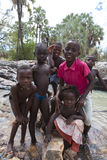 Himba children having fun in the river at the Epupa Falls river, Stock Photo