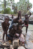 Himba children having fun in the river at the Epupa Falls river, Stock Images