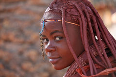 Himba girl in Namibia. Himba girl with a christian cross in Namibia Royalty Free Stock Photo