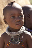 Himba Nomadic tribe - Namibia. Young boy of the Himba Nomadic Tribe in Damaraland in Northern Namibia. The Himba are an ethnic group of about 20,000 to 50,000 Royalty Free Stock Photo