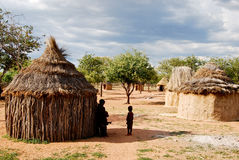 Himba village with traditional huts near Etosha National Park in Namibia Royalty Free Stock Photography