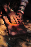 Himba woman grinding ochre Royalty Free Stock Photos