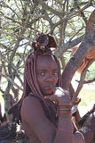 Himba woman hiding under the tree Royalty Free Stock Photography