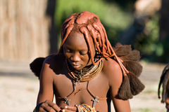 Himba woman looks down, Namibia. Stock Images