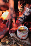 Himba woman mixing red ochre with petroleum jelly Royalty Free Stock Photos