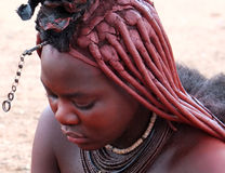 Himba woman, Namibia. Young unidentified Himba woman with ethnic hairstyle in northern Namibia Royalty Free Stock Photography