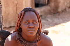 Himba woman with ornaments on the neck in the village Royalty Free Stock Images