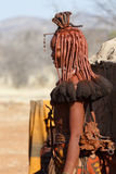 Himba woman with ornaments on the neck in the village Stock Photography