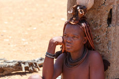 Himba woman with ornaments on the neck in the village Stock Images