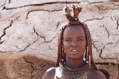 Himba woman with ornaments on the neck in the village Stock Photos