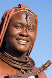 Himba woman portrait. With traditional jewelry on blue sky background Royalty Free Stock Image