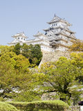 Himeji Castle Hill. View of Himeji white complex castle in the hill with a lot of trees Royalty Free Stock Photos