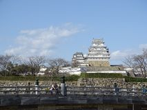 Himeji Castle. In Himeji, Japan. This castle is known for its white facade. This photo shows the main keep of the castle. Taken from the front entrance of the royalty free stock photography