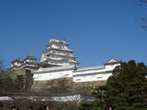 Himeji Castle. In Himeji, Japan. This castle is known for its white facade. This photo shows the main keep of the castle, surrounded by the turrets around it royalty free stock photo