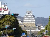 Himeji Castle. In Himeji, Japan. The castle stands tall in the middle of the city. This picture shows a mix of the ancient and the modern stock photos