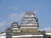 Himeji Castle. In Himeji, Japan. This castle is known for its white facade. This photo shows the main keep of the castle royalty free stock image
