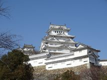 Himeji Castle. In Himeji, Japan. This castle is known for its white facade. This photo shows the main keep of the castle, surrounded by the turrets around it stock photos