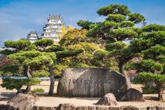 Himeji Castle Stone Monument with the Castle in the back. Himeji Castle, Hyogo Prefecture, Japan -November 8, 2018: Himeji Castle Stone Monument surrounded by stock images