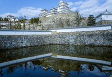 Himeji castle or White Egret Castle. Amazing Japanese national architecture - Himeji castle or White Egret Castle, reflected in the waters of the lake.  It is a Stock Photo