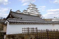 Himeji castle or White Egret Castle. Amazing Japanese national architecture - Himeji castle or White Egret Castle, standing on large foundation from a stone. It Royalty Free Stock Images