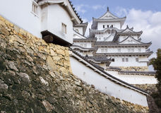 Himeji castle or White Egret Castle. Amazing Japanese national architecture - Himeji castle or White Egret Castle, standing on large foundation from a stone. It Royalty Free Stock Photography