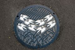 The Beauty nature pattern of Japan's Manhole Cover on the sidewalk. royalty free stock photos