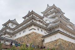 Himeji slott i Japan som kallas också den vita hägerslotten royaltyfri bild