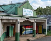 The Himeville mini mall with mailboxes painted in the colours of the South African flag. Himeville in Southern Drakensberg, South Africa, is close to the start royalty free stock image