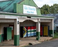 The Himeville mini mall with mailboxes painted in the colours of the South African flag. Himeville in Southern Drakensberg, South Africa, is close to the start stock photography