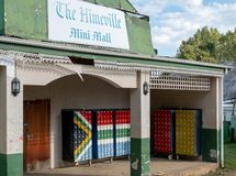The Himeville mini mall with mailboxes painted in the colours of the South African flag. Himeville in Southern Drakensberg, South Africa, is close to the start stock image