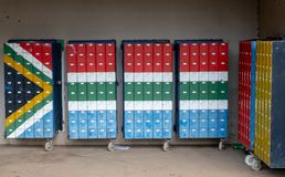 The Himeville mini mall with mailboxes painted in the colours of the South African flag. Himeville in Southern Drakensberg, South Africa, is close to the start stock photo