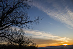 Himlen och solnedgången Arkivbild
