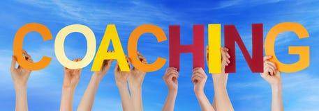 Himmel för coachning för ord för handhåll färgrik rak Royaltyfri Foto