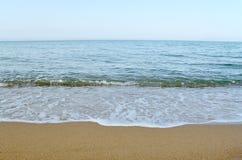 Himmel, hav och sand arkivfoto