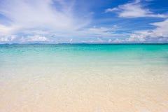 Himmel, hav och strand Arkivfoto
