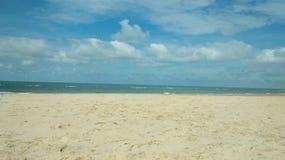 Himmel, hav och strand arkivbild